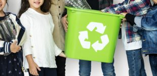 A group of young children recycling